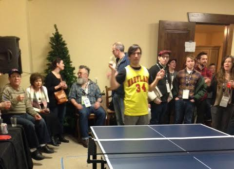 Michael Tully plays ping pong at PING PONG SUMMER party.